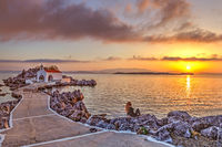 A woman at the sunrise in Chios island, Greece