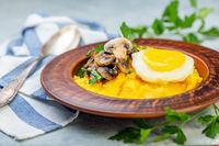 Polenta with caramelized mushrooms, egg and parsley.