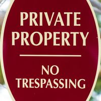 Square frame Oval shape Private Property No Trespassing sign with red and white colors