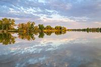 Calm fishing lake with sunset rteflection