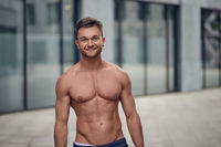 Attractive muscular young man posing shirtless