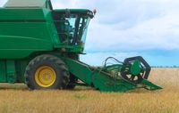 green harvester working in the field, harvester harvesters