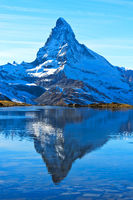 The Matterhorn, Mont Cervin, is reflected in lake Stellisee, Zermatt, Valais, Switzerland