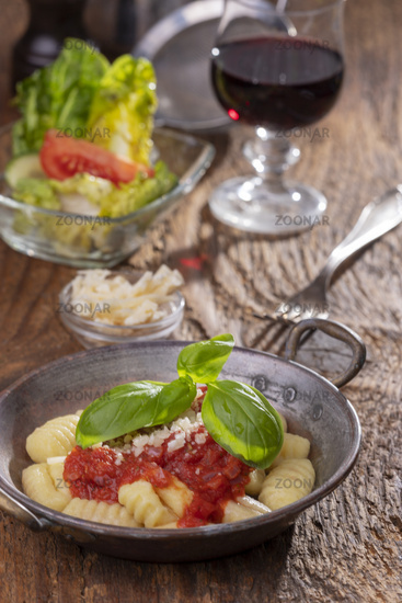 Close-up of gnocchi with sauce on wood