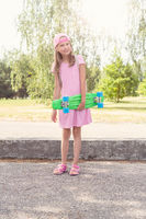 Girl with green penny skateboard
