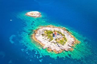 Aerial view of lonely island with lighthouse