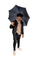 Black man standing in the studio with umbrella