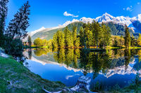 Alps are reflected in the lake