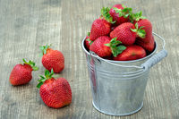 Small bucket with strawberries