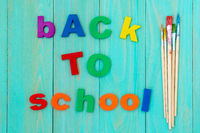Sentence BACK TO SCHOOL with a paint-brushes