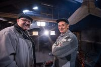 portrait of two confident senior blacksmith