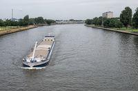 Ship at Dutch Amsterdam Rijn canal sailing near city Utrecht