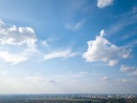 A large modern city of Kiev against the blue sky, a panorama of the city,Ukraine. Photo from the drone