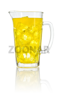 An orange soft drink with ice cubes in a pitcher