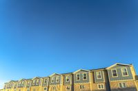 Townhomes exterior view with clear blue sky in the background on a sunny day