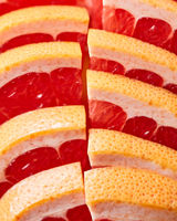 Fresh slices of ripe grapefruit presented in a row. Healthy Diet Fruit. Flat lay