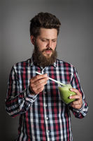 Man with spinach smoothie