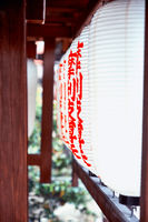 Old traditional red and white Lanterns outside of japan temple