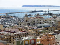 Beautiful view from a hill in Alicante. Houses and harbour.