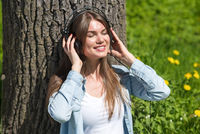 Woman with headphones in park