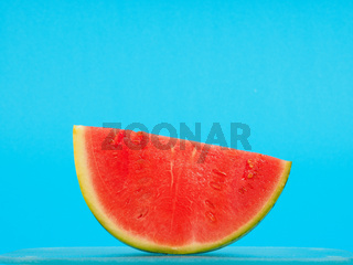 Slice of watermelon on blue