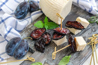 Dried spicy plums and artisanal soft cheese.