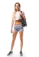 beautiful sporty woman with sports bag goes to training, isolated on white
