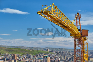 Jib crane tower against blue sky