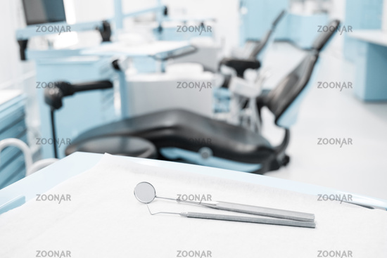 dentist clinic concept with dental tools and dentist chair in background