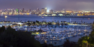 Illuminated harbor and city in San Diego at night