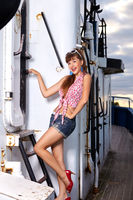 beautiful girl in pinup style on ship