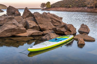 inflatable stand up paddleboard  on mountain lake
