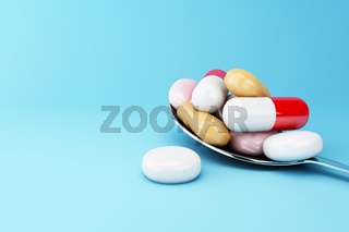 3d Spoon full of colorful pills and capsule.