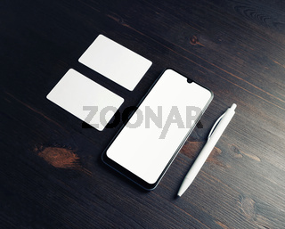 Smartphone, business cards, pen