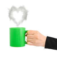 Hand with cup and steam like a heart