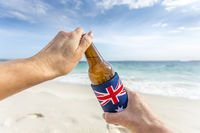 Beach party holiday mode, open a cold beer on beach