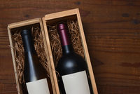 A bottle of Chardonnay and Cabernet Sauvignon wine in wood gift boxes