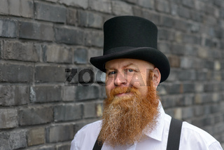 Charismatic bearded man with a playful grin