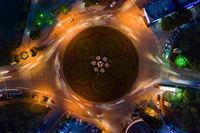 aerial view of traffic circle island at night