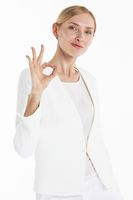 Businesswoman showing okay hand sign
