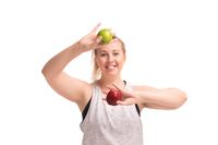 Funny fat girl in sportswear with apples shot