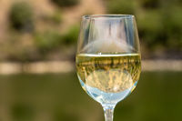 Glass of white wine on a cruise boat on Douro river in Portugal