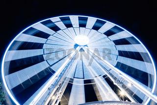 Ferris Wheel Spinning Long Exposure Neons Structure against Black Night