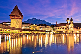 Luzern Kappelbrucke bridge and church with Pilatus mountain background evening view