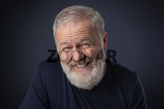 Old man portrait smiling fake
