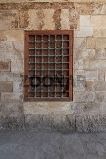 Mamluk era wooden closed window with wooden ornate grid over stone bricks wall, Blue Mosque, Cairo, Egypt