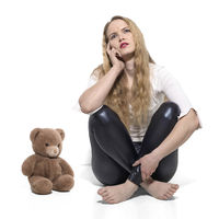 Young blond woman with teddy bear