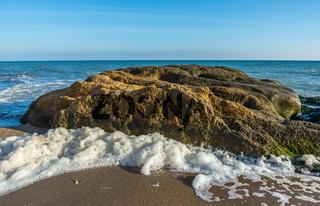 Big Limestone rock on the seashore