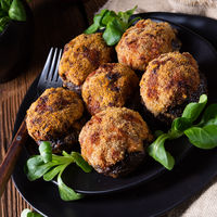 stuffed with minced meat and baked Champignons
