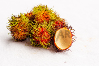 fresh and tasty rambutan, shaggy fruit sold in Asia, Thailand and Vietnam on a white isolated background